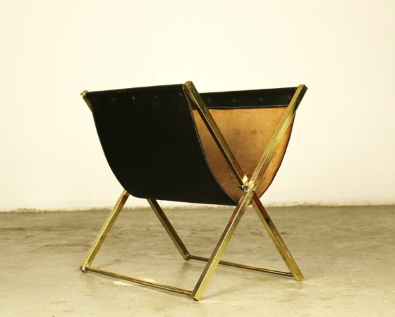 Mid-century magazine rack in the style of Jacques Adnet Brass